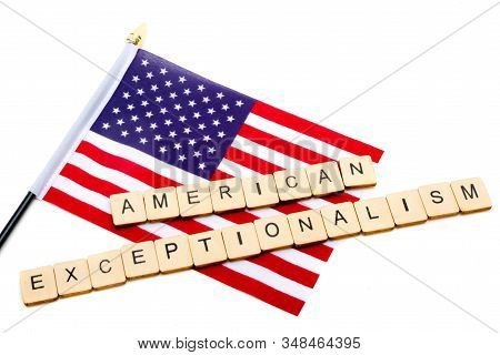 The Flag Of The United States Isolated On A White Background With A Sign Reading American Exceptiona