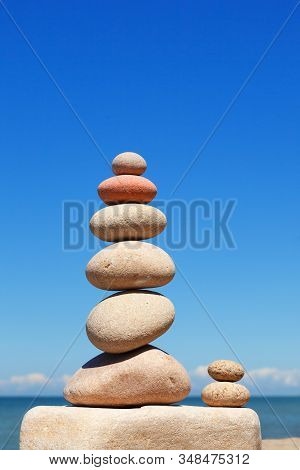 High Rock Zen Pyramid Of White And Pink Pebbles On The Beach. Concept Of Life Balance, Harmony And M