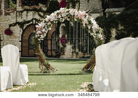Blooming Decoration Of Wedding Arch With Roses, Hydrangea And Eucalyptus. Wedding Wood Decoration. W
