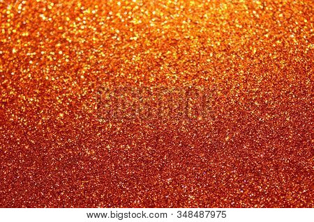 The Picture Shows A Red Glittery Background