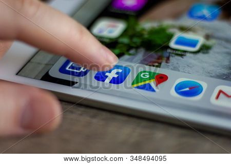 Brecht, Belgium - November 14 2019: A Portrait Of A Finger Of A User Above The Facebook Application