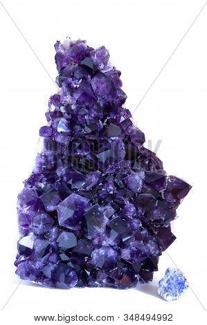 Big Violet Amethyst Crystal Gemstone On White Background
