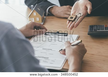 Customer Signing Contract For A New House.