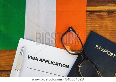 Flag Of Ireland , Visa Application Form And Passport On Table