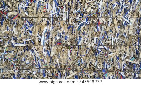 Bales of cardboard and box board. Wastepaper for Recycling. Background of paper textures piled ready