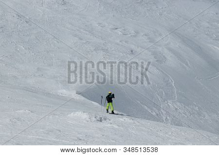 Tourist In Alps Photographs The Valley Below Him. Swiss Alps And Only One Freeride Man. Young Boy Do