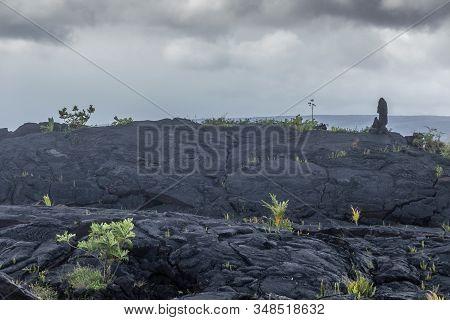 Kaimu Beach, Hawaii, Usa. - January 14, 2020: Hardened In Waves Black Lava Field Off Kilauea Volcano