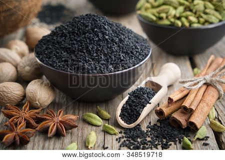 Healthy Black Cumin Or Roman Coriander Seeds And Aromatic Spices: Cardamom, Nutmegs, Cinnamon Sticks