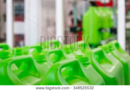 A Many Green Plastic Cans Canister On A Pallet, Production Of Plastic Products Pvc Extrusion Method