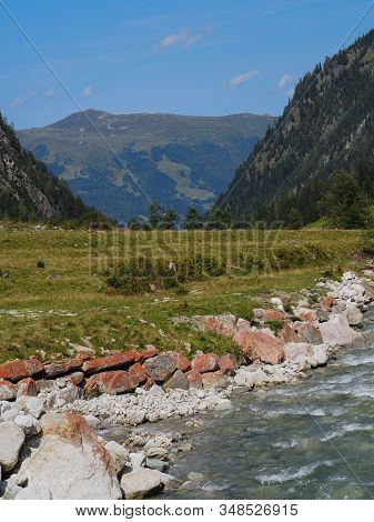 Wild Mountain Creek Downstream In Summer Time
