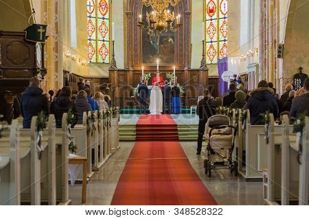 City Cesis, Latvia. Utheran Pastor Married. People Come To The Wedding Watching The Ceremony. 25.01.