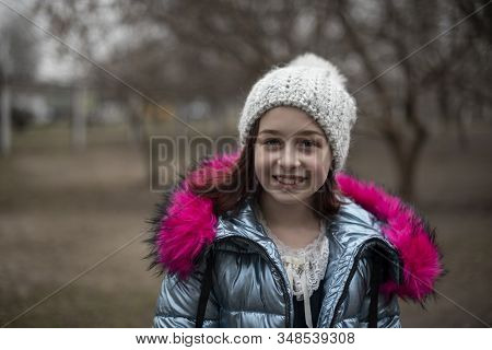 Close Up Portrait Of A Beautiful Nine Year Old Little Girl In Park. 9 Years Old Girl In A Hat And A