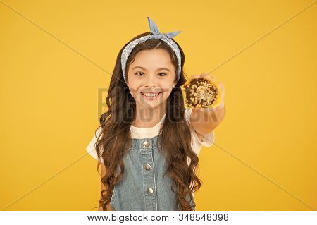 Happy Childhood. Bakery Confectionery Concept. Kid Girl Hold Muffin. Delicious Cupcakes. Little Chil