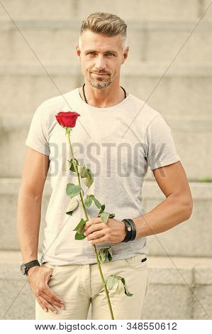 How To Be Romantic. Romantic Gentleman. Man Mature Confident Macho With Romantic Gift. Handsome Guy