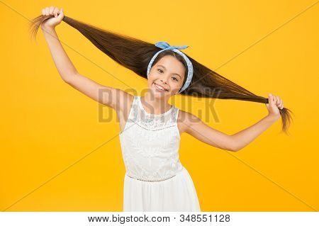 The Joy Of Best Hair. Happy Child Hold Long Hair. Little Hair Model With Fashion Look. Hair And Beau