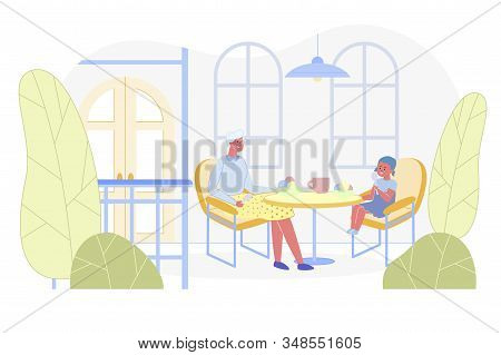Grandmother And Granddaughter Visiting Cafe. Happy Little Child With Granny Sitting At Table In Cafe