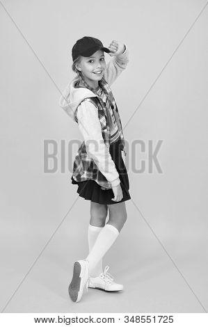 Cool Schoolgirl. Have Fun Charismatic Girl On Yellow Background. Tomboy Concept. Teen Age. Girl Ador