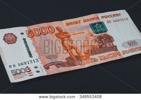 One Russian Bill In The Amount Of 5000 Rubles Lies On A Black Background.
