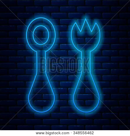 Glowing Neon Line Baby Plastic Cutlery With Fork And Spoon Icon Isolated On Brick Wall Background. C
