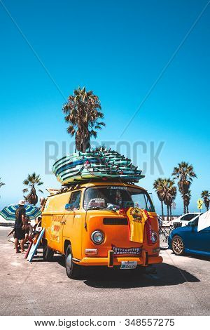 Venice Beach, Los Angeles Usa - May 15, 2019: A Classic Sunny Orange Volkswagen Van Full With Surf B