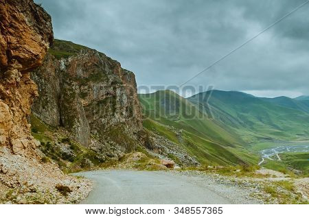 Cycling Mountain Road. Misty Mountain Road In High Mountains.. Cloudy Sky With Mountain Road