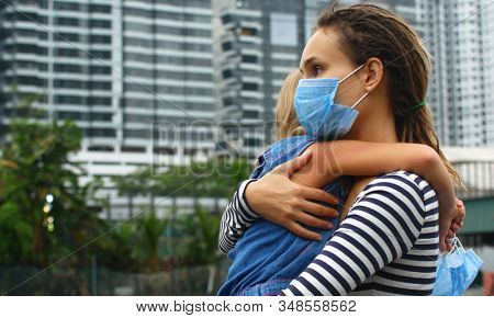 Parent hugs the child. Fighting the 2019-nCoV Virus Outbreak