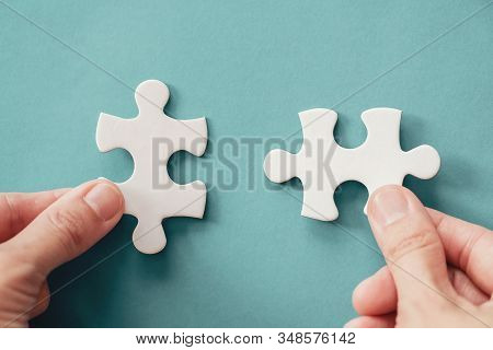 Hands With Jigsaw Puzzle Pieces, Business Strategy Planning, Alzheimer's Disease, Autism And Mental