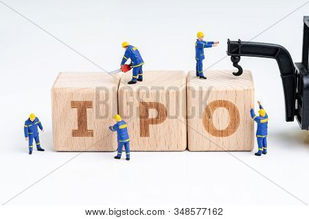 Cube Wooden Block With Alphabets Combine The Word Ipo With Miniature People Men Help Building With C