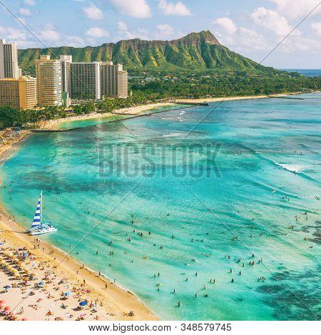 Hawaii waikiki beach in Honolulu city, aerial view of Diamond Head famous landmark travel destination. Mountain peak at sunset, Oahu island, USA vacation.