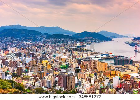 Nagasaki, Japan downtown cityscape on the bay at twilight.