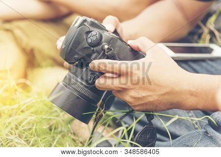 Young Professional Photographer Camera Dslr Photo Person Portrait Photographer Checking Photo From C