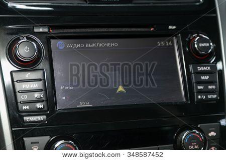 Novosibirsk, Russia - December 01, 2019:  Nissan Teana,  Car Dashboard Monitor Audio In Fm-receiver,