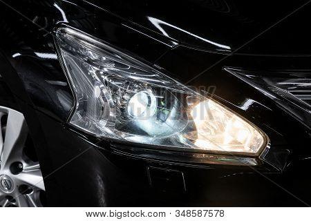 Novosibirsk, Russia - December 01, 2019:  Nissan Teana,  Macro View Of Modern Red Car Xenon Lamp Hea