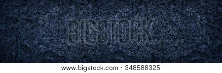 Dark Deep Blue Wide Background. Rough Crumpled Surface Large Panoramic Texture