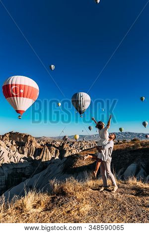 Honeymoon Trip. Couple In Love Among Balloons. A Man Proposes To A Girl. Couple In Love In Cappadoci