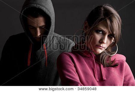 Teenagers Against Dark Background