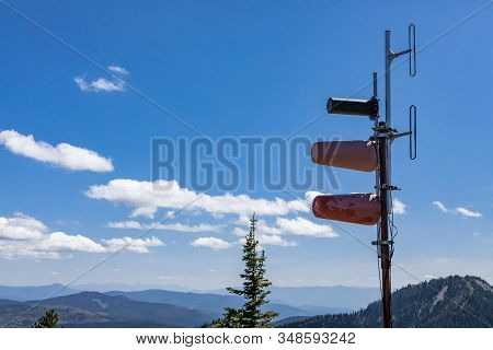 A Special Cellular And Radio Antenna Located High Up On The Hilltop Of Kootenay Valley Mountains, In