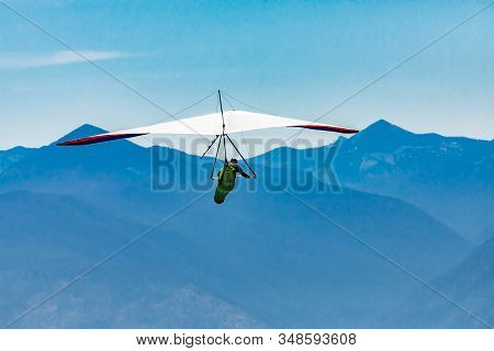 Hang Gliding Over Great Mountains. Soaring Flight Of Hang-glider Pilot Over Kootenay Valley Mountain