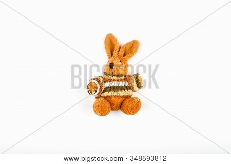 Brown Plush Hare On A White Background. Old Plush Brown Retro Hare On White Wall Background.