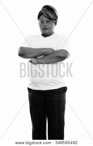 Studio Shot Of Fat Black African Woman Standing With Arms Crossed Ready For Gym