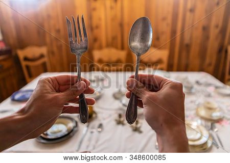 Hands Holding Fork And Spoon, Getting Prepared To Start Eating. Discover Historical Kitchen Relics I