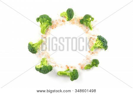 Broccoli Florets, Shot From The Top On A White Background, With Himalayan Salt, Forming A Frame For
