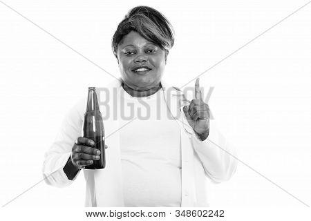 Studio Shot Of Overweight African Woman Doctor