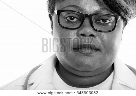 Close Up Of Fat Black African Woman Doctor Wearing Eyeglasses