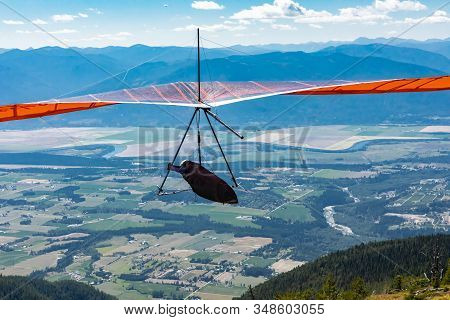 Hang Glider In Soaring Flight Off. Recreational Extreme Air Sport For Brave Hobbyists. Flight Over K