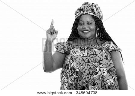Portrait Of Beautiful Overweight African Woman With Traditional Clothes