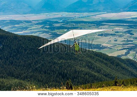 Hang Gliding In Action. Extremal Air Sports. Recreational Leisure Activities. Scenic View Over Koote