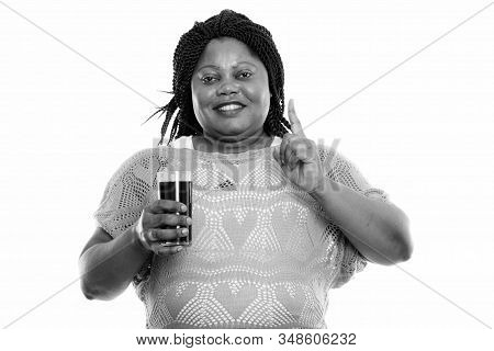 Studio Shot Of Beautiful Overweight African Woman With Braids