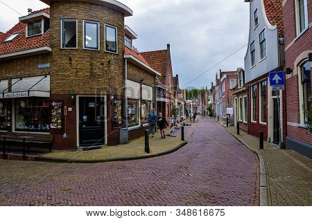 Edam, The Netherlands, August 2019. A Street In The Historic Center: The Small And Pretty Red Brick