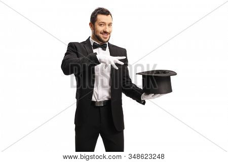 Magician making a magic trick with a top hat isolated on white background